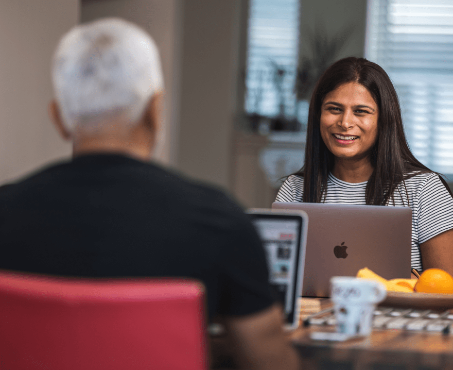 Customer experience expert working from home, interacting with her partner
